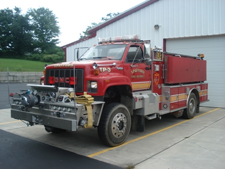 Spafford TP-3 - 1993 GMC/US Tank Tanker Pumper. The truck carries 1250 gallons of water, 2000 feet of four inch hose, and is equipped with a foam proportioning unit.